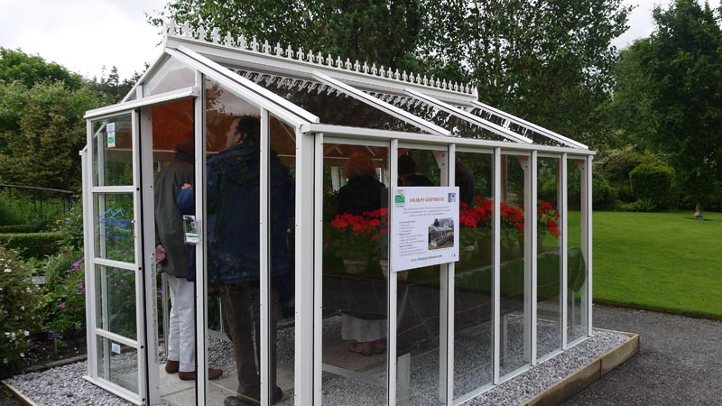 how to build a greenhouse with glass panels